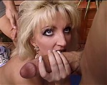 Horny housewife wraps her lips around an enormous cock